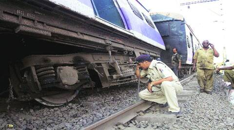 Police inspect the derailed coaches. (IE)