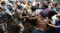 Protesting workers turn violent, 12 cops injured