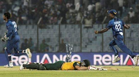 Sri Lanka's Kumar Sangakkara and Nuwan Kulasekara celebrate as South Africa's David Miller fails to make his ground (AP)