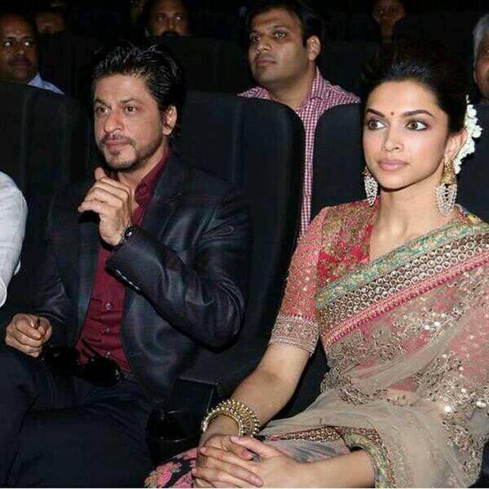 Shah Rukh and Deepika are engrossed at the event. (Photo: Twitter)