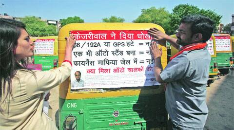 Auto drivers launch a poster campaign against Arvind Kejriwal on Friday.  Amit Mehra