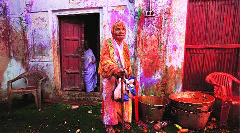 A widow celebrates Holi with colour for the first time.