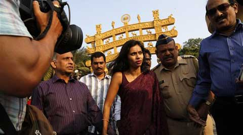 In this Tuesday, Jan. 14, 2013 file photo, diplomat Devyani Khobragade, center, arrives at Chaitya Bhoomi, a memorial to Indian freedom fighter B.R. Ambedkar, with her father Uttam Khobragade in Mumbai, India. (AP)