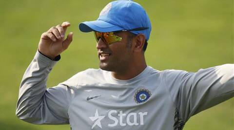 India's captain Mahendra Singh Dhoni gestures to a teammate during a training session. (AP)