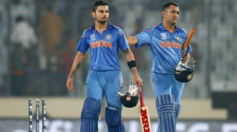 India's captain Mahendra Singh Dhoni, right, and teammate Virat Kohli celebrate their win over Bangladesh in the ICC Twenty20 World Cup (AP)