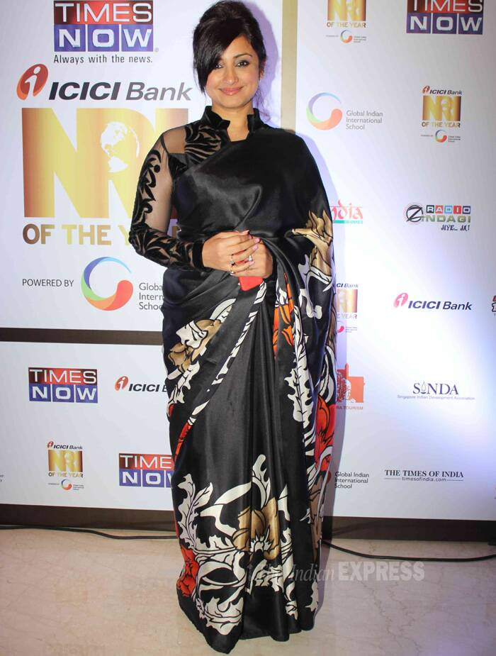 Divya Dutta,  who was seen in 'Bhaag Milkha Bhaag', wore a black printed sari with a sheer long-sleeved blouse. (Photo: Varinder Chawla)