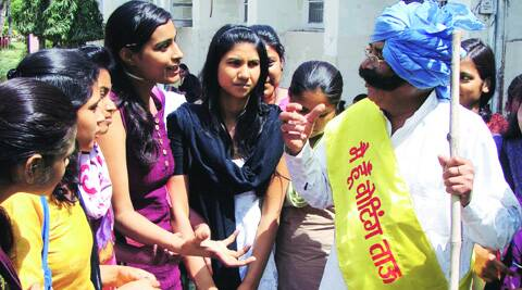 A 'Voting Tau' interacts with a group of girls in Gurgaon. (Express Photo)