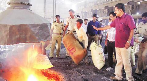 Customs officials burn the drugs at Markal in Khed taluka on Friday. photos: Rajesh Stephen
