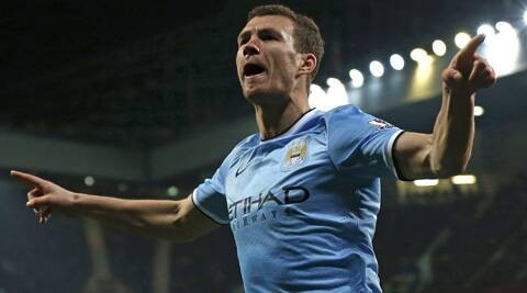 Manchester City's Edin Dzeko celebrates his second goal against Manchester United at Old Trafford on Tuesday. (Reuters)