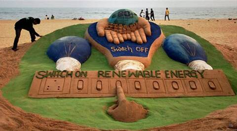 Sudarsan Patnaik, put up a 7 feet large sand sculpture at the Puri sea beach in support of Earth Hour on Saturday. (AP)