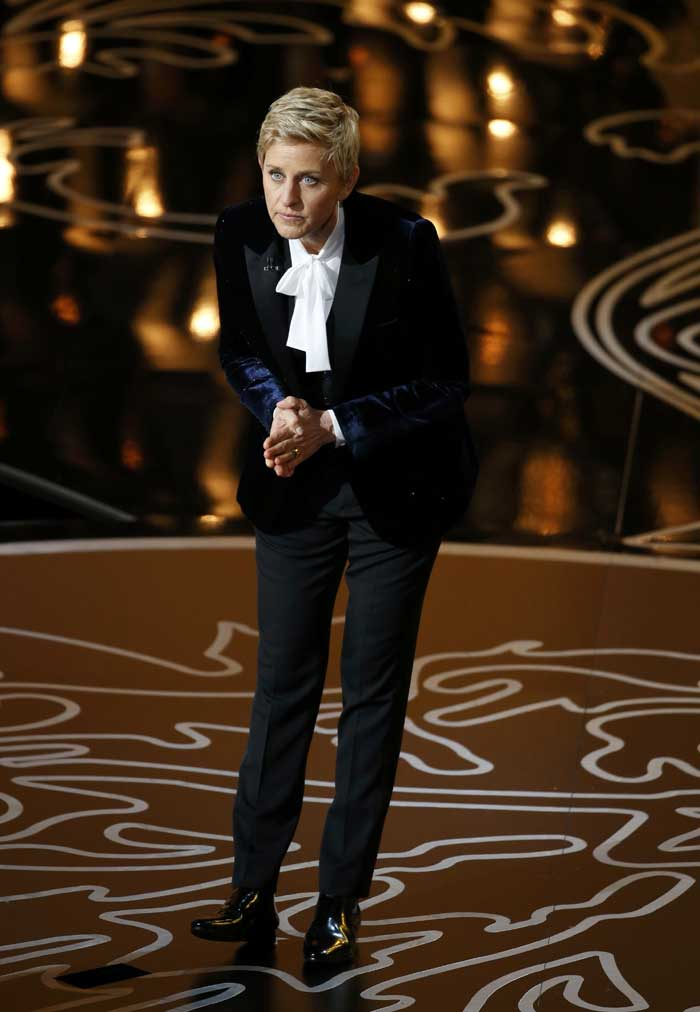 "Making her entrance dressed in a black tuxedo and white ascot, DeGeneres, 56, noted the lengthy interval between her two Academy Awards emcee gigs. ""I hosted seven years ago, and I'm so honored and flattered that they had me back so quickly,"" she said. (AP)"