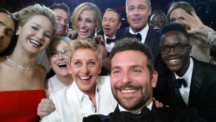 "Ellen also took a ""selfie"" snapshot with a group of nominees that was swiftly re-tweeted more than 2 million times during the show. (AP)"