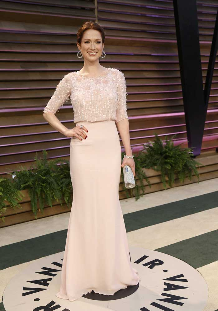 Actress Ellie Kemper was dainty in the pinkish dress with sequin bodice. (AP)