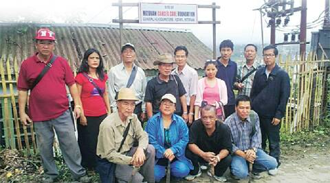 Mazami (in pink) and Pastor Maenga (standing, extreme right) with cancer patients at the Mizoram Cancer Care Foundation.