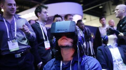 A file photo of a delegate playing a video game wearing Oculus Rift virtual reality headsets at the Intel booth at the International Consumer Electronics Show (CES), in Las Vegas this year. (AP)