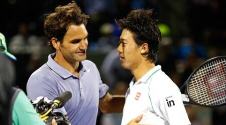 Kei Nishikori shakes hands with Roger Federer after their match on day ten of the Sony Open. (USA Today Sports)