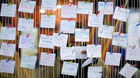 Notes offering support to relatives of those on Malaysia Airlines Flight 370. (Reuters)