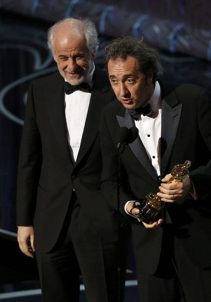 "Director Paolo Sorrentino (R) actor and Tony Servillo accept the Oscar for best foreign language film for the Italian movie ""The Great Beauty"" at the 86th Academy Awards in Hollywood. (Reuters)"