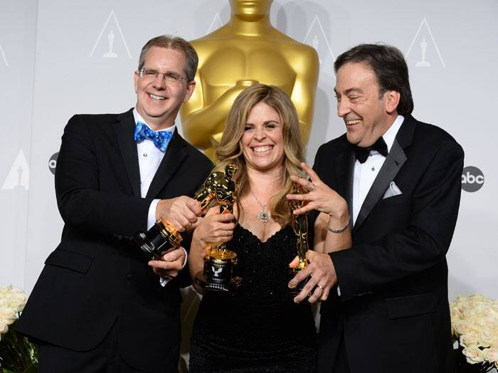 "Best Animated Feature Film: Frozen<br /><br /> Chris Buck, from left, Jennifer Lee and Peter Del Vecho pose with the award for Best animated feature film of the year for ""Frozen"" (AP)"