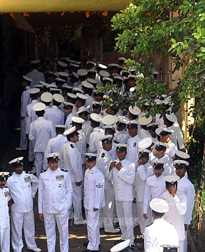 Lt Commander Kapish Munwal, one of the two Navy officers who died in the fire onboard INS Sindhuratna off Mumbai coast two days ago, was cremated in Mumbai with full military honours. (IE Photo)