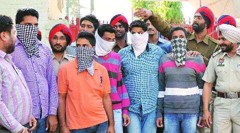 Police with the arrested gang members. (Gurmeet Singh)