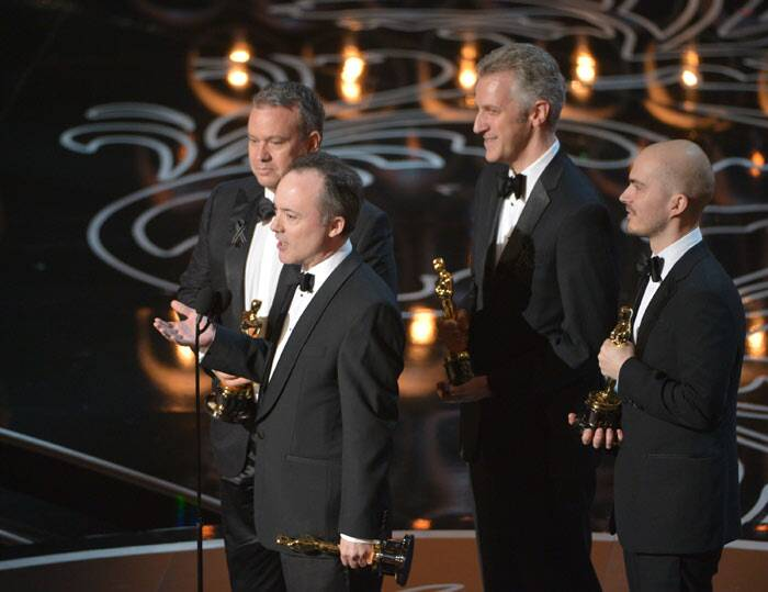 Best Visual Effects: Gravity <br /><br /> Neil Corbould, from left, Tim Webber, David Shirk, and Chris Lawrence accept the award for best visual effects for Gravity. (AP)