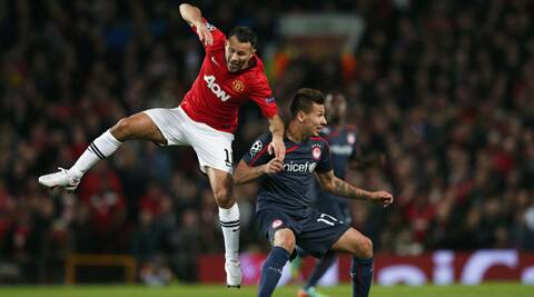 Handed his first start in 11 games,  Giggs provided key passes to set up the opening two goals in a 3-0 win over Olympiakos.