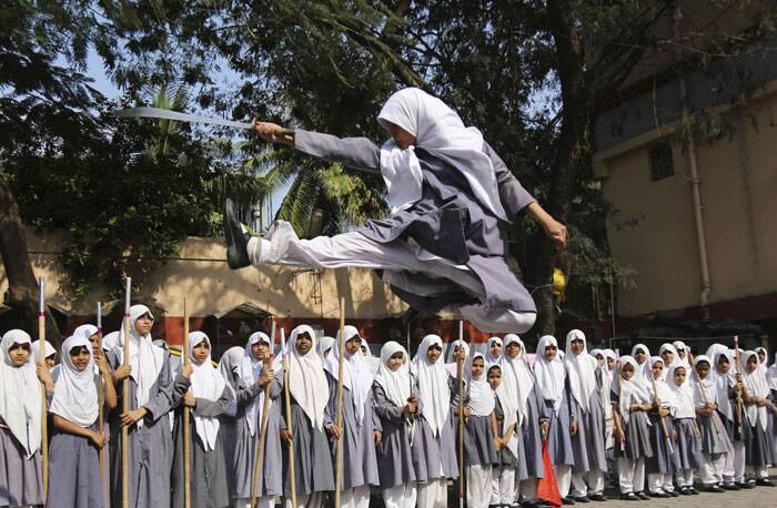A Muslim girl performs martial arts during a function to mark International Women's Day at a school in Hyderabad. (AP)