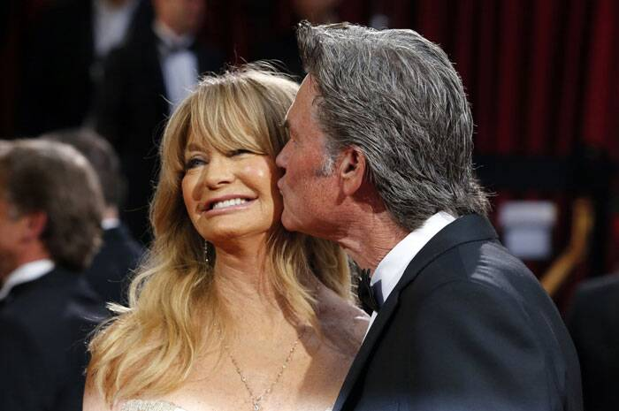 Veteran actress Goldie Hawn gets a peck on the cheek from partner Kurt Russell.