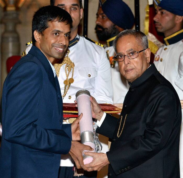 President Pranab Mukherjee presents Padma Bhushan award to former Indian badminton player Pullela Gopichand. (PTI)