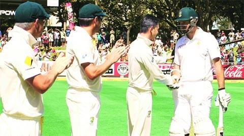 Australia's captain Michael Clarke (2nd R) greets Graeme Smith as he comes out to bat for the last time (Reuters)