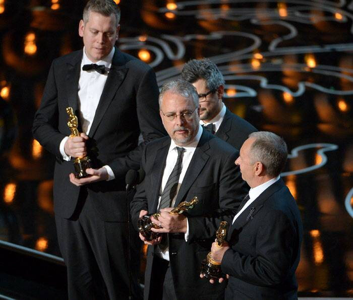 "Best Sound Mixing: Gravity<br /><br /> Christopher Benstead, Niv Adiri, Skip Lievsay, and Chris Munro accept the award for best sound mixing for ""Gravity"". (AP)"