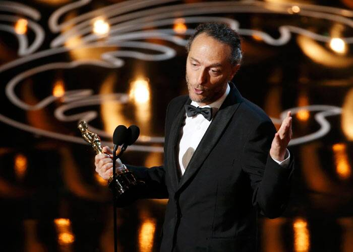 "Best Cinematography: Gravity <br /><br /> Emmanuel Lubezki, cinematography winner for ""Gravity"", speaks on stage. (Reuters)"