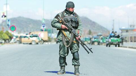 An Afghan policeman stands guard near the site of an attack in Kabul on Tuesday. Reuters