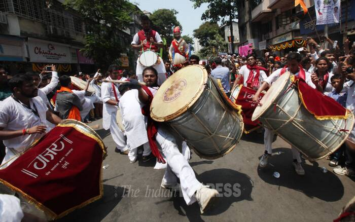 """People dressed in traditional attire dance during a procession as they celebrate """"Gudi Padwa"""" or the Marathi new year. (IE Photo:Pradip Das)"""