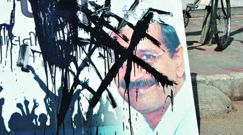A blackened poster of Arvind Kejriwal in Ahmedabad Thursday. (Express)