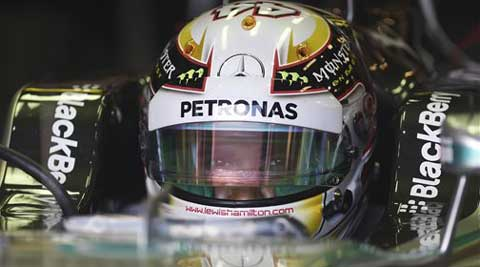 Mercedes driver Lewis Hamilton of Britain sits in his car during the third practice session at Albert Park ahead of the Australian Formula One Grand Prix.