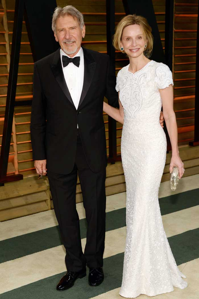 Harrison Ford and Calista Flockhart pose at the 2014 Vanity Fair Oscar Party. (AP)