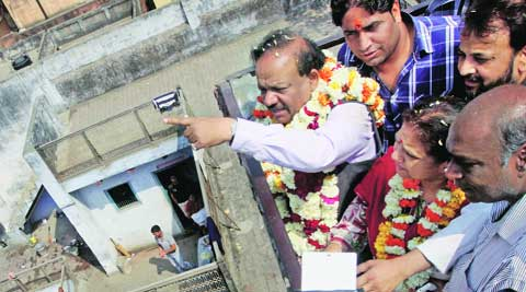 Harsh Vardhan was born in 3240, Fatak Teliyan. (Above) Vardhan with supporters at the house on Saturday. prem nath pandey.