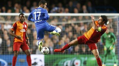 Chelsea's Eden Hazard (C) is challenged by Galatasaray's Selcuk Inan during their Champions League soccer match at Stamford Bridge (Reuters)