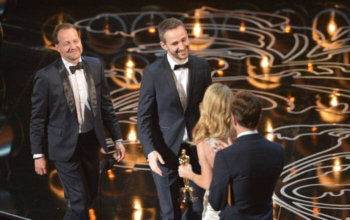 Best Live Action (Short Film): Helium<br /><br /> Kim Magnusson, left, and Anders Walter walk on stage to accept the award for best live action short film of the year for Helium. (Reuters)
