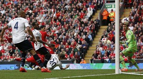 Tottenham Hotspur's Hugo Lloris (R) watches as Liverpool's Jordan Henderson (unseen) scores from a free kick during their English Premier League soccer match at Anfield in Liverpool (Reuters)