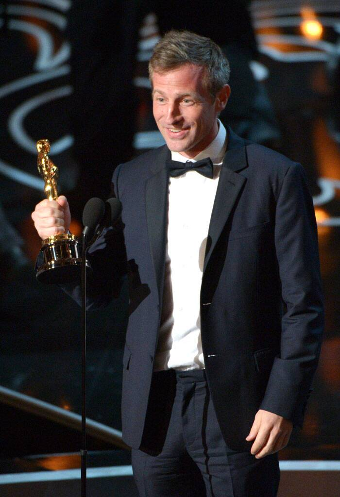 "Spike Jonze accepts the award for the best original screenplay of the year for ""Her""during the Oscars at the Dolby Theatre in Los Angeles. (AP)"