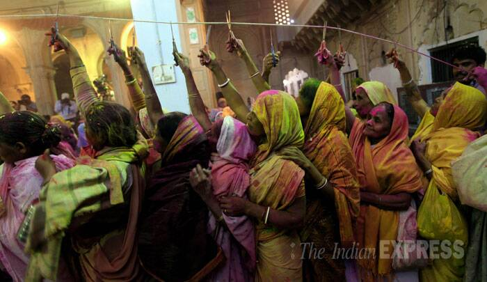 About 1000 widows, shunning the shackles of social stigma, played Holi with colours and gulal at Meera Sahabhagini Ashram here on Friday. (IE Photo: Ravi Kanojia)