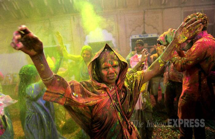 It was for the first time that the widows gathered in such a large number to play Holi with gulal and water colour at the 200-year-old Ashram. (IE Photo: Ravi Kanojia)