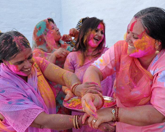 BJP mahila morcha workers celebrate Holi, the festival of colors in Bikaner on Saturday. (PTI)