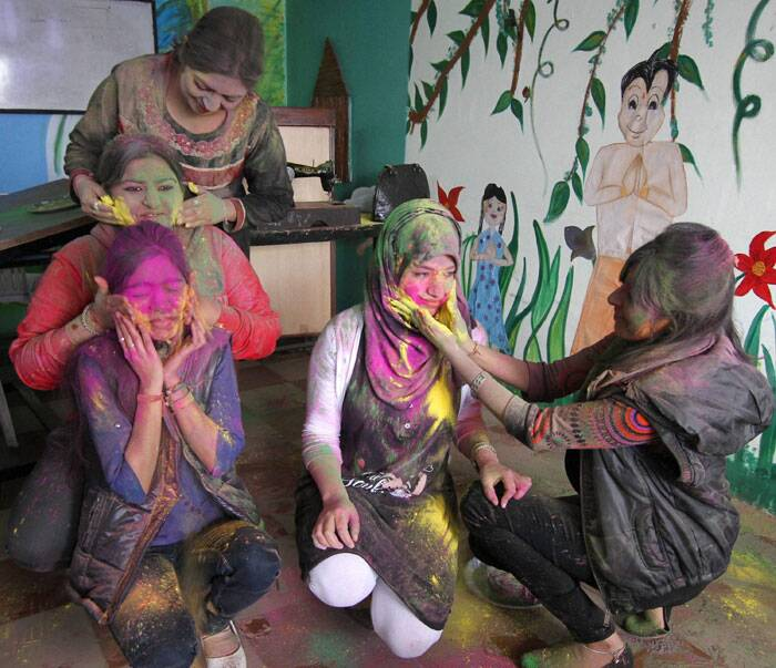 Girls celebrate Holi at their college in Jammu on Saturday. (PTI)
