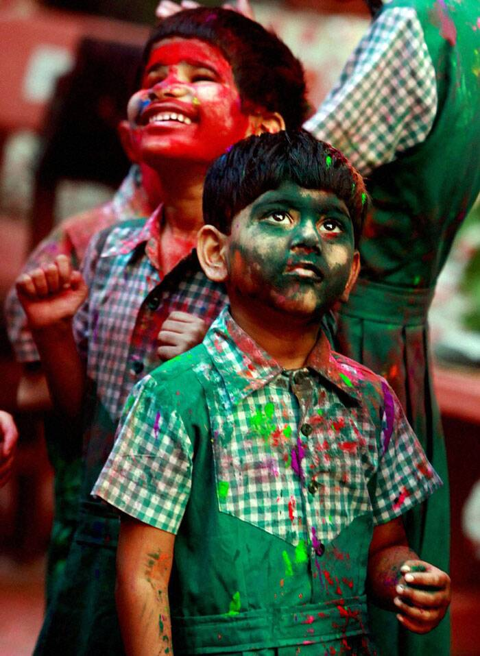 Blind girls playing Holi at a school in Mumbai on Friday. (PTI)