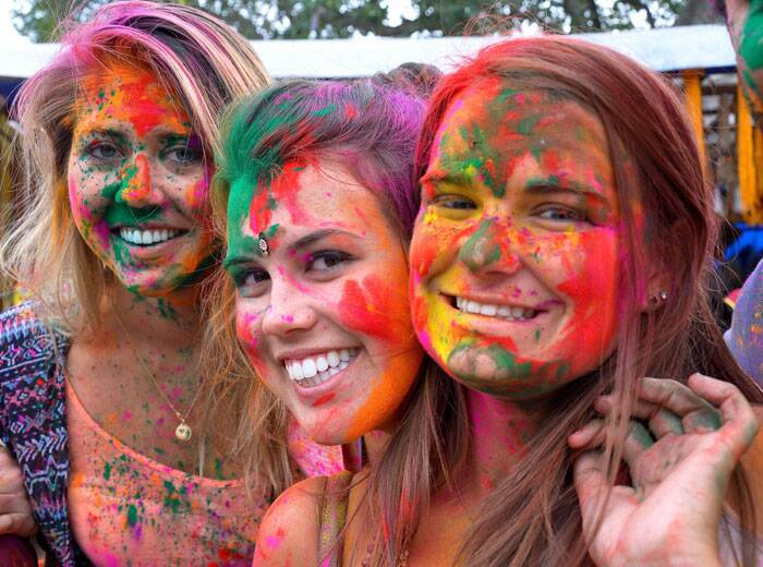 Foreign tourists during a Holi celebration in Jaipur on Friday. (PTI)