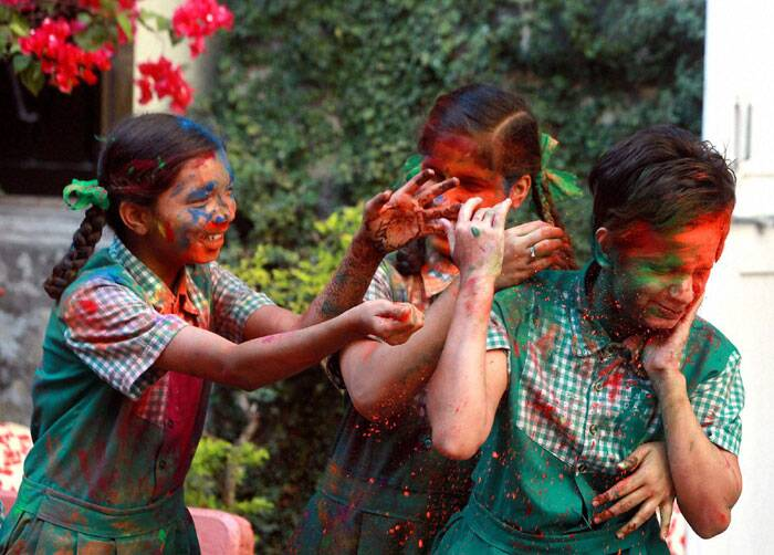 Children are excited to play Holi. (PTI)